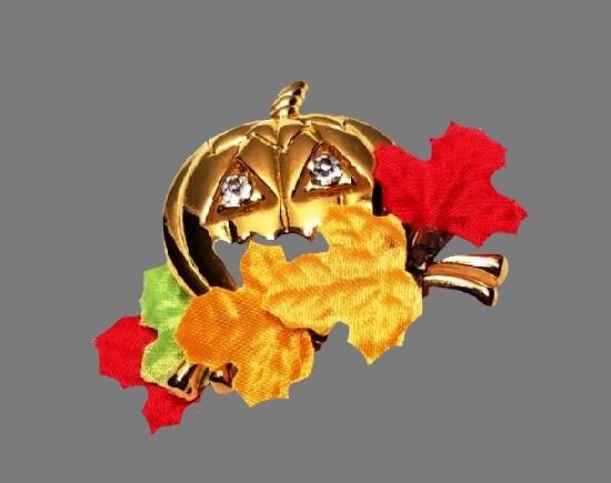 Halloween pumpkin and autumn leaves brooch for Avon. Gold tone alloy, enamel, rhinestones. 1987
