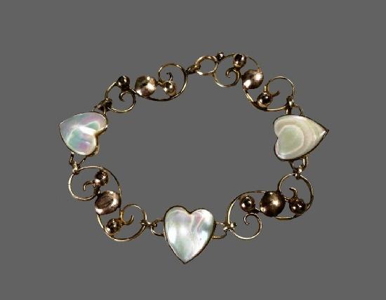 Heart design bracelet. 12 K gold, opal. 1930s