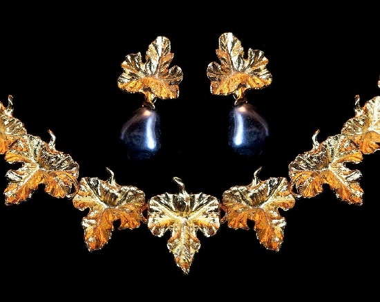 Leaf design necklace and clip on earrings. Gold tone metal, faux baroque pearl