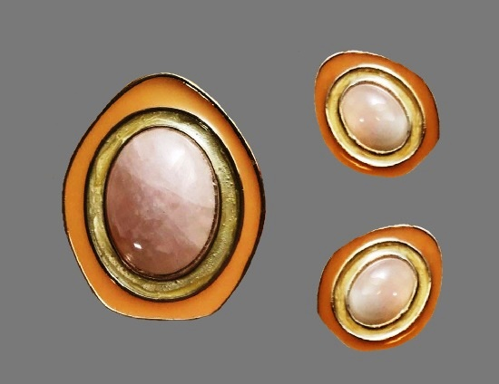 Made for Avon clip on earrings and brooch pendant. Gold tone metal, rose quartz cabochon. 1980s