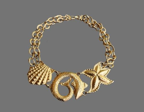 Marine design starfish shell fish gold tone necklace. 1980s