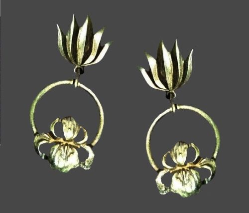 Orchid design gold tone dangling clip on earrings. 1980s