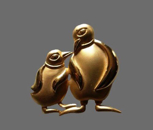 Penguins gold tone brooch