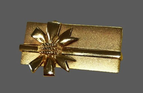 Present with bow gold tone pin