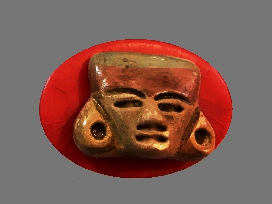 Red galalith tribal mask brooch
