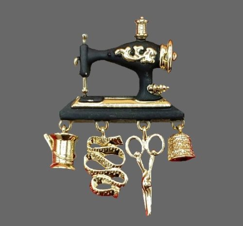 Sewing Machine with dangling sewing themed charms vintage brooch. Gold tone metal, plastic