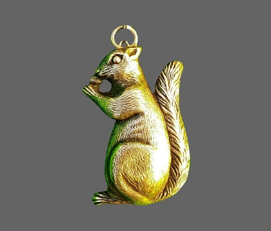 Squirrel eating a nut pendant charm. Sterling silver. 1922