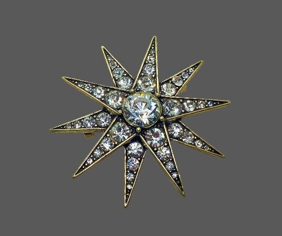 Star brooch. Gold tone metal, clear rhinestones