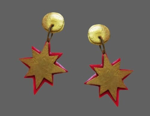 Starburst red enamel gold tone earrings. 1980s