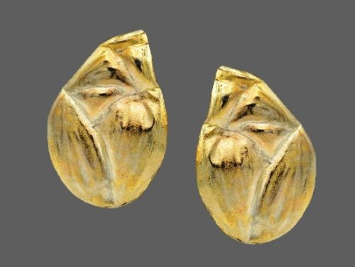 Teardroop shaped brushed silver tone earrings. 1980s