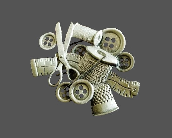 Thread, needles, scissors, buttons and measuring tape pewter brooch