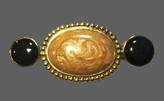 Two round black stones beige enamel oval shaped brooch