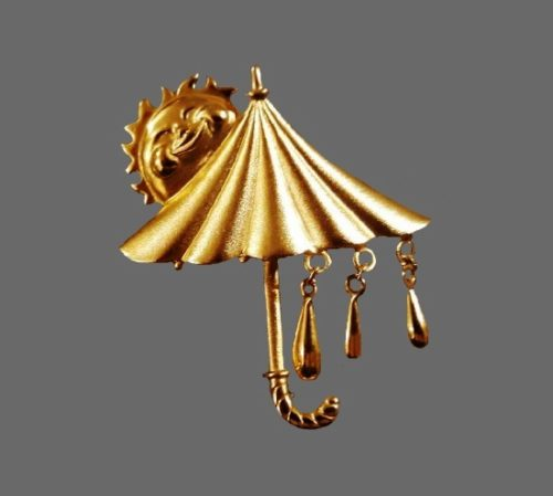 Umbrella with rain drops and sun brooch. Matte gold tone metal. 1980s