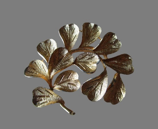 Branch with leaves gold tone brooch