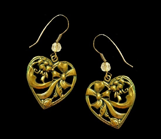 Bow inside heart gold tone earrings with glass bead