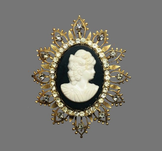 Cameo brooch pendant. Gold tone metal alloy, clear rhinestone, carved shell