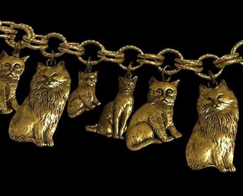 Cat charm bracelet of gold tone