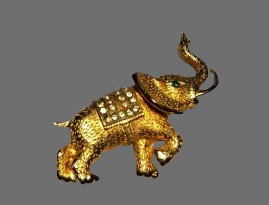 Elephant brooch. Textured gold tone metal, rhinestones