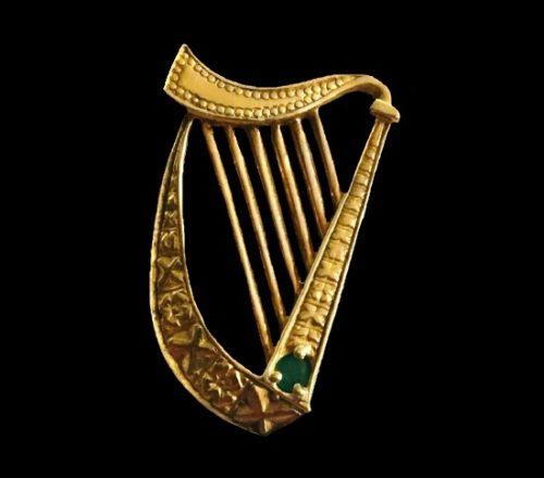 Harp pendant. Sterling silver, gold, emerald. 1982