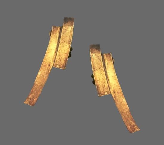 Modernist design clip on earrings of gold tone
