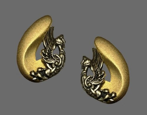 Mythological design gold and silver tone clip on earrings. 1982