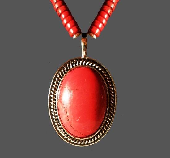 Red stone silver tone pendant