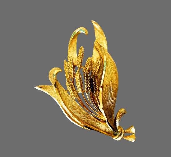 Wildflower bouquet gold tone brooch