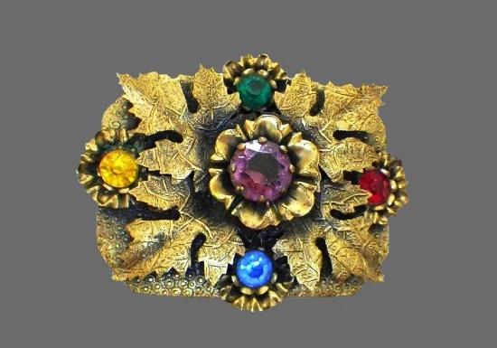 Art Nouveau floral design brooch pin. Multicolor Czech art glass, rhinestones, brass. 1930s