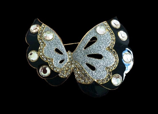Assymetrical butterfly brooch. Gold tone, silver and black enamel, crystals
