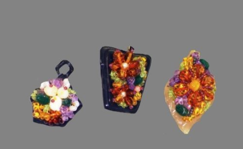 Colorful amber pendants made from unique material, horn of water buffalo, brass, pearl, amethyst, garnet. Artist Sachiko Fukaya