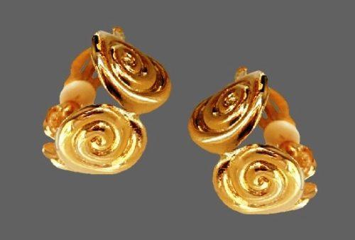 Hoop swirl design clip on earrings of gold tone. 1980s