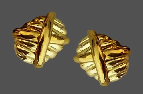 Ribbed and X accented gold tone clip on earrings. 1970s