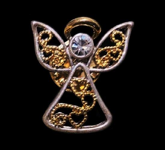 Filigree design angel lapel pin. Gold and silver tone metal, rhinestone