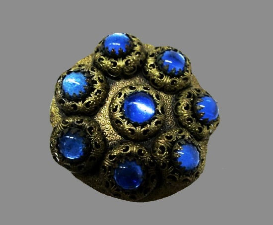 Filigree design brooch. Blue art glass,brass. 1930s