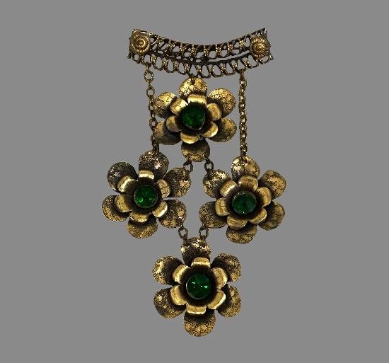 Large brass tone flower dangles green stone brooch