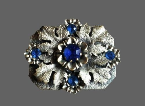 Leaf and flower design silver tone textured metal deep blue rhinestones brooch