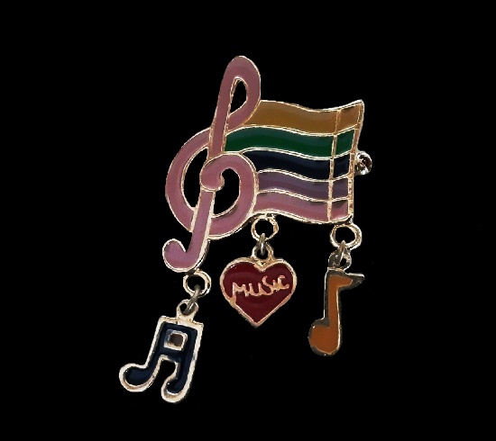 Music brooch with charms. Gold tone alloy, enamel