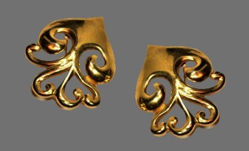 Ornamental design yellow gold tone clip on earrings