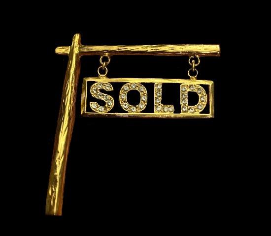 'Sold' gold tone rhinestones brooch pin