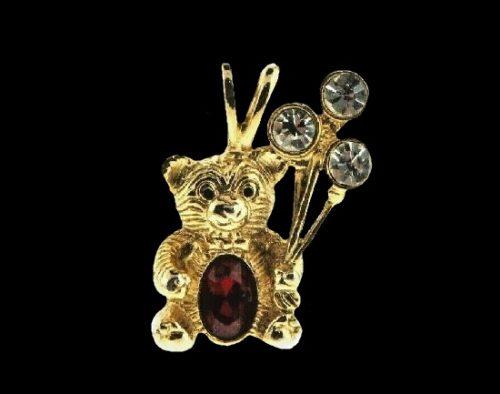Teddy bear with balls pendant. Gold tone metal alloy, rhinestones. 1999