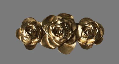 Three Roses gold tone brooch