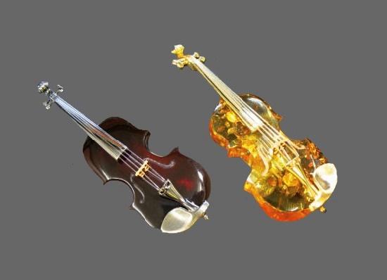 Violin brooches made of amber, press-amber and silver