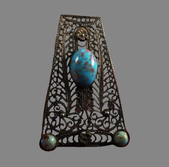 Wire filigree design dress clip. Turquoise art glass, silver tone metal. 1930s