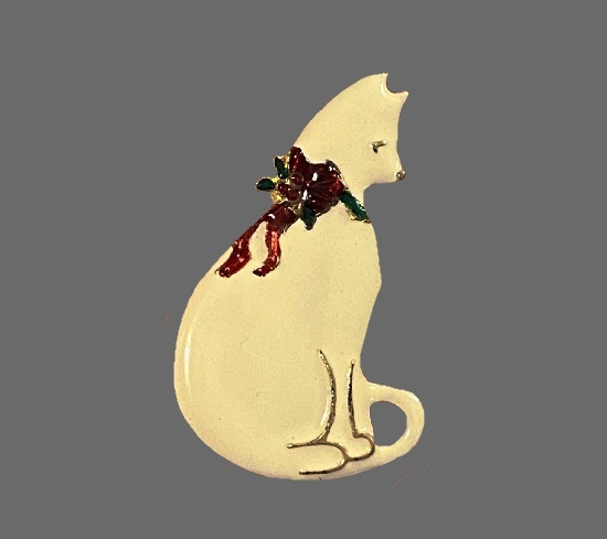 Cat with a bow vintage brooch. Gold tone metal, enamel