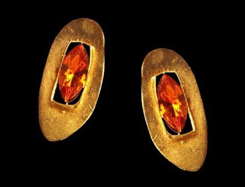 Green glass gold tone clip on earrings