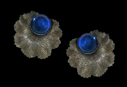 Royal blue glass textured silver tone textured metal leaf design clip on earrings