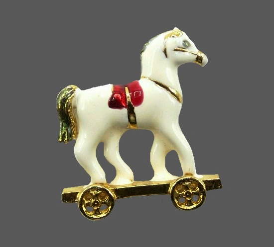 White toy horse on wheels red saddle brooch. Gold tone, enamel