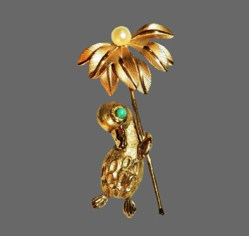 A duckling holding a flower vintage brooch. Sterling silver, 12K gold plated, cultured pearl, turquoise bead eye