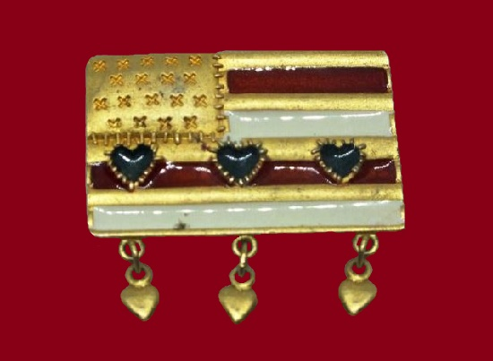 American flag patriotic brooch with dangling heart charms. Gold tone metal alloy, enamel