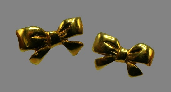 Bow design gold tone clip on earrings